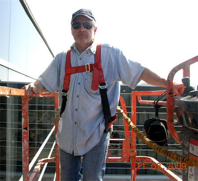 Mark Meshulam inspects curtainwall from boom lift