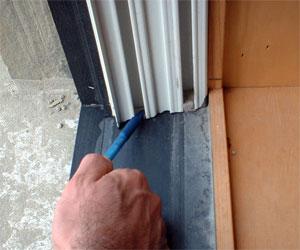 Vinyl jamb liner in wood double hung window