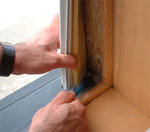 Wood window jamb liner being removed
