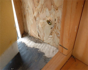 Unsealed frame joint in wood window showing water damage