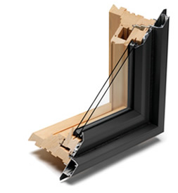 Wood window with aluminum cladding