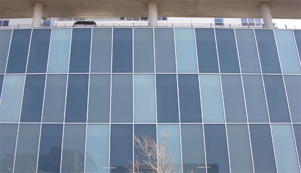 This is a stick-built fully captured curtainwall at Skybridge, enclosing the parking garage.