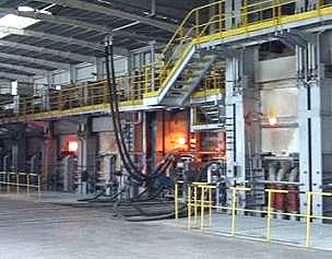 Float glass plant, where silica sand and other powders are melted and floated on a bed of molten tin to create flat glass