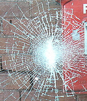 Picture of broken glass.Typical impact glass breakage without puncture