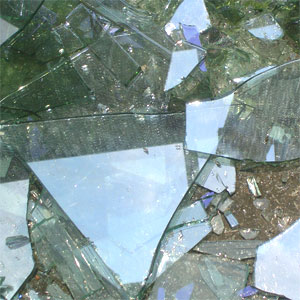 Photo of broken glass. Danger of broken glass injury. Glass shards from broken annealed or heat strengthened glass are dangerous and must be handled with care.