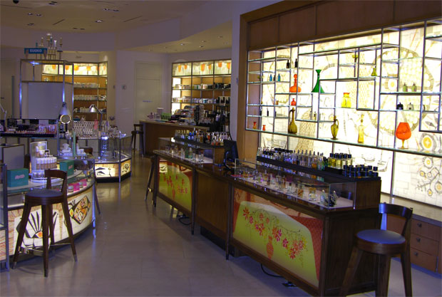 Across Sands Avenue, in the Palazzo, Barneys creates an upbeat and uplifting environment by placing colorful backlit patterns behind the glass in display walls and counter bases.