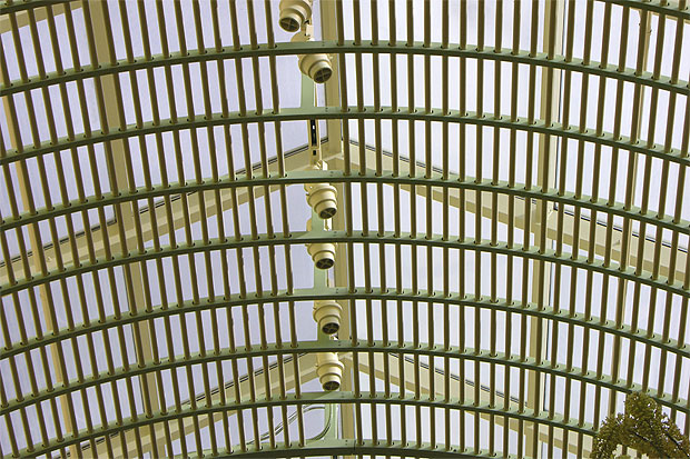 Detail at Wynn Hotel buffet skylight. An elaborate birdcage of metal grill-work is built within and beneath the skylight, creating a cascade of light.