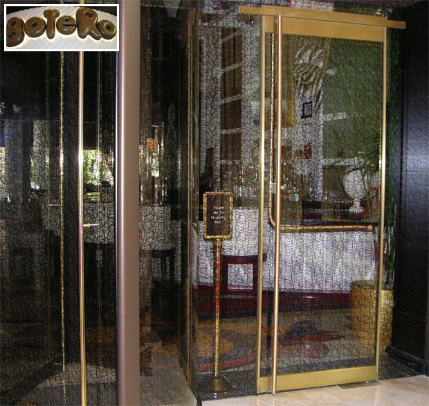Next door, the Botero Restaurant uses a stylized laminated glass interlayer in the doors, sidelites and revolving door leafs and enclosure.