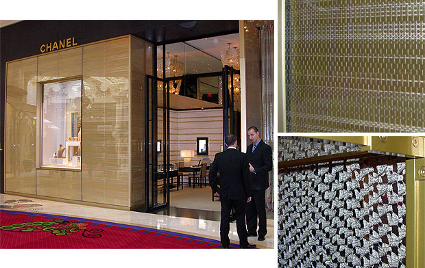 The Chanel at the Wynn Hotel doesn't try to provide a psychadelic experience, but rather the experience of wealth, however vicarious that might be. The storefront glass is backed by a rich, golden (what else?) fabric seen enlarged at the upper right. Interior partitions consist of two layers of a beautiful open weave fabric, sandwiched between three lites of glass. The separation between the fabric layers give the pattern life as you walk by.