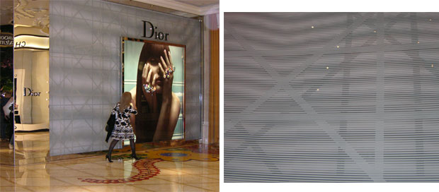 The Dior store in the Wynn Hotel retail esplanade. Here, a pattern screened onto the back of the glass is repeated on a background a few inches behind the glass, producing a changing Moire pattern as you walk by. In this case, the designers seem to want the visitor to feel as if he is using illegal substances.
