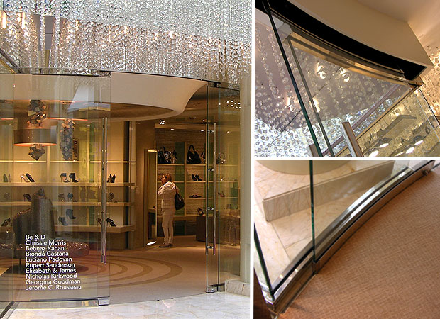In the Encore Hotel retail corridor, the In Step store kicks up its heels with a curved, rolling, heavy glass pair of doors.