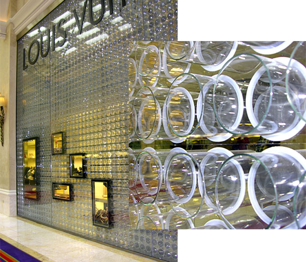 The Louis Vuitton storefront in the Wynn Hotel retail esplanade. The highly stylized glass wall appears to be composed of hundreds of glass cylinders suspended in holes in a vertical sheet of glass. One wonders if illegal substances were utilized in the creation of this design.