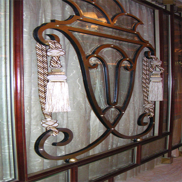 Private gambling area at the Wynn Hotel. Interest is added through the use of tassles, and the omission of glass in the area immediately surrounding the urn shape.