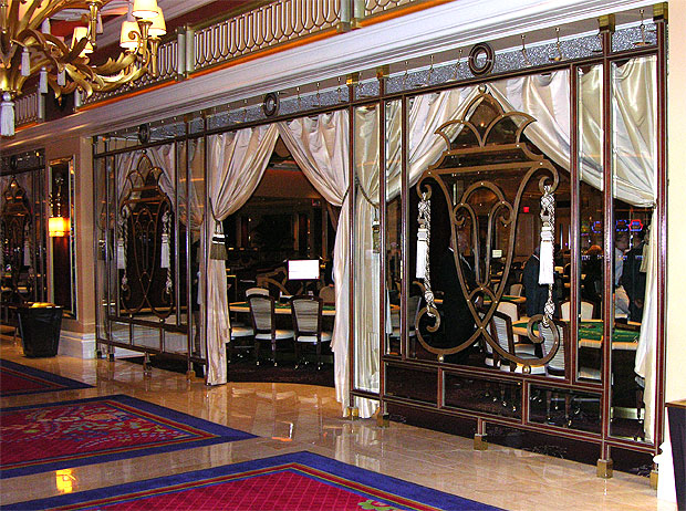 Glass and metal combine to create an exciting private enclosure for the losing of ones life savings at the Wynn Hotel.