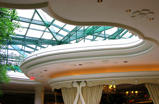 Complex, beautiful details like this abound at the Wynn Hotel. This skylight extends up and over a soffit wrapping the perimeter of the Parasol Up bar. The effect is amplified by the use of mirrors at the perimeter of the skylight.