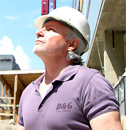 Mark Meshulam, Chicago Window Expert, looking at glass