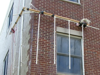 We utilized a spray rack on a masonry corner that is known to leak, in order to view the leaks on the interior