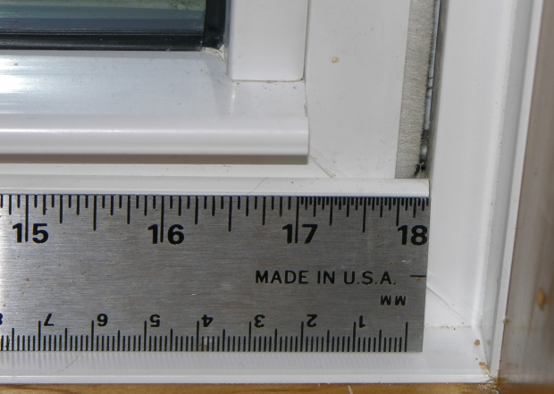 The horizontal parts on this lower sash are too short, resulting in a large gap between the side of the vinyl sash and the adjacent frame. The weatherstrip is supposed to be compressed 30%. Instead it is uncompressed and has a nearly 1/8