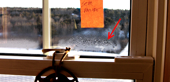Insulated glass seal failure in vinyl window