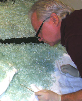 Mark Meshulam inspecting broken shower door glass