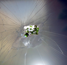 Broken glass evidence with daylight visible at origin