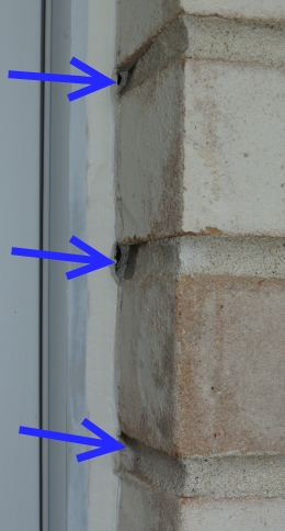 Failing window perimeter caulk is coming away from the brick mortar, allowing air and water into the building