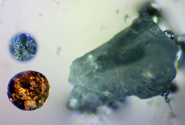 Composite photo showing relative sizes of two nickel sulfide inclusions next to a grain of salt.