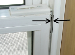 Bad shimming of double hung window causes air leaks