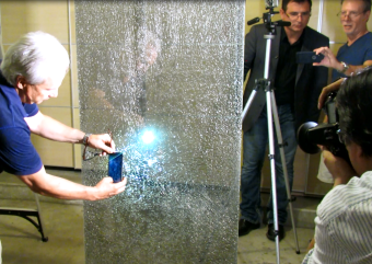 Mark Meshulam and a CBS news team with Dave Savini examine glass breakage staged for the TV news