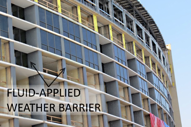 Fluid applied weather barrier used in building under consruction