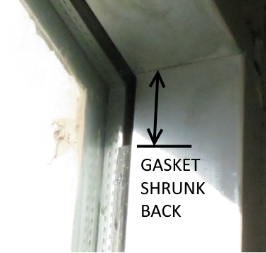 Typical condition around glass. Interior gaskets are shrunken back. If gaskets shrink in length, this means they also shrink in thickness. Needed support for the glass is reduced as a result